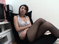 Sexy brunette asian shows ass upskirt in nylon stockings
