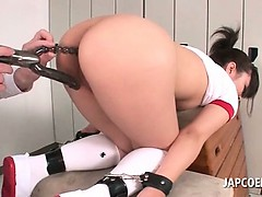 Brunette Japanese school chick gets pain in the neck and cunt toyed